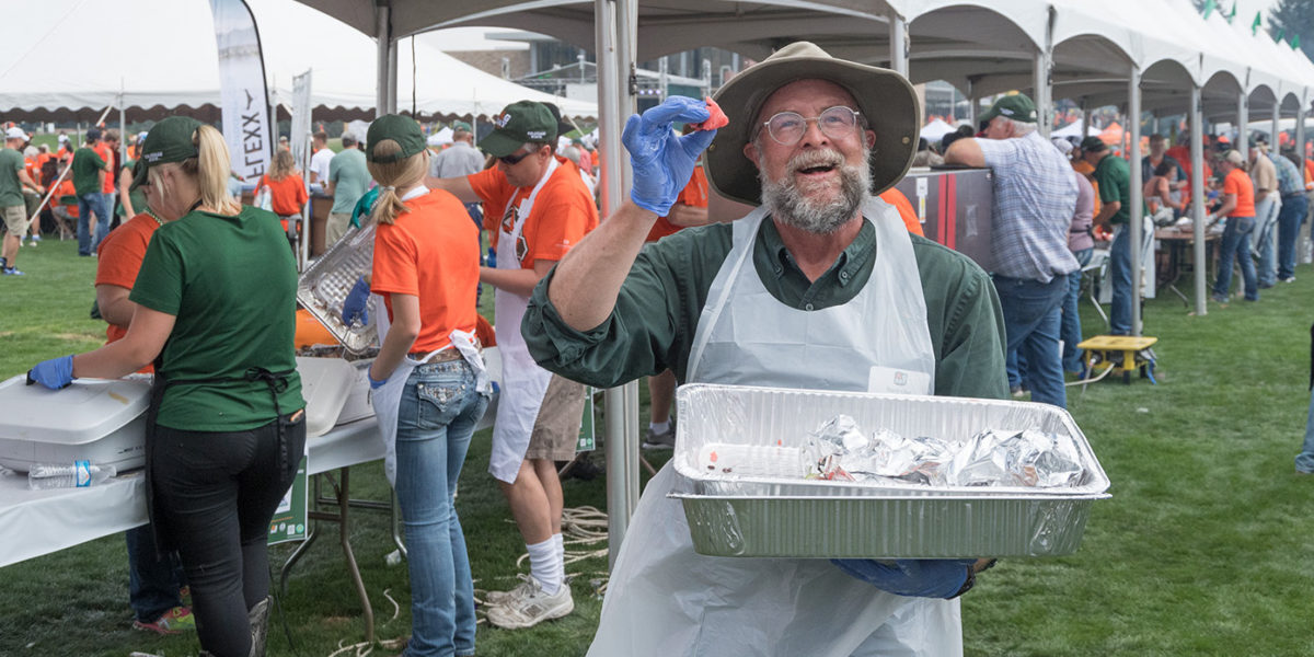 A volunteer helping at CSU's 2017 Ag Day