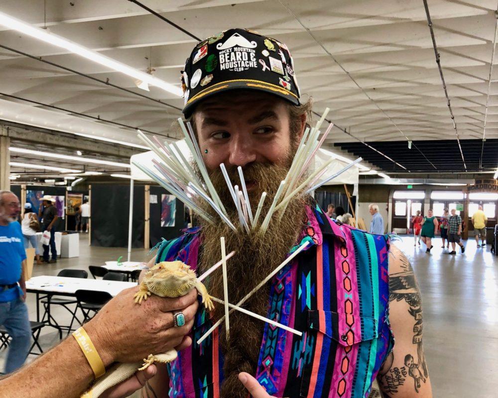 Denver 4-H's bearded dragon, Clem, next to winner of beard contest at 2018 Denver County Fair.