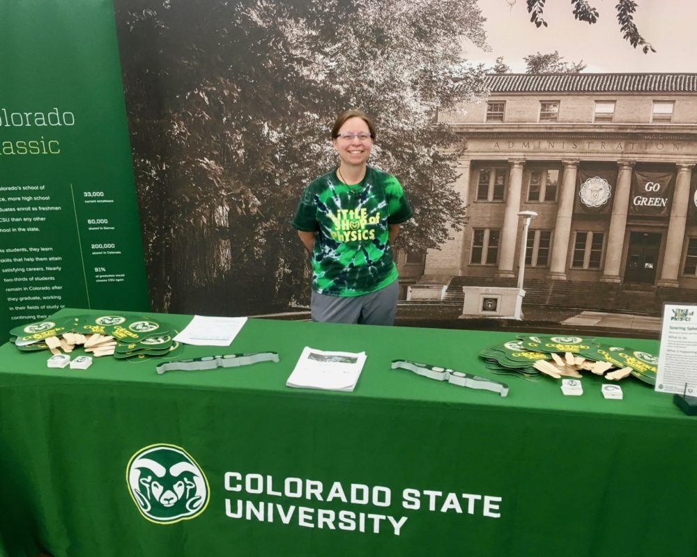 Heather Michalak, assistant director of CSU Little Shop of Physics, smiles at CSU's booth at the 2018 Denver County Fair.