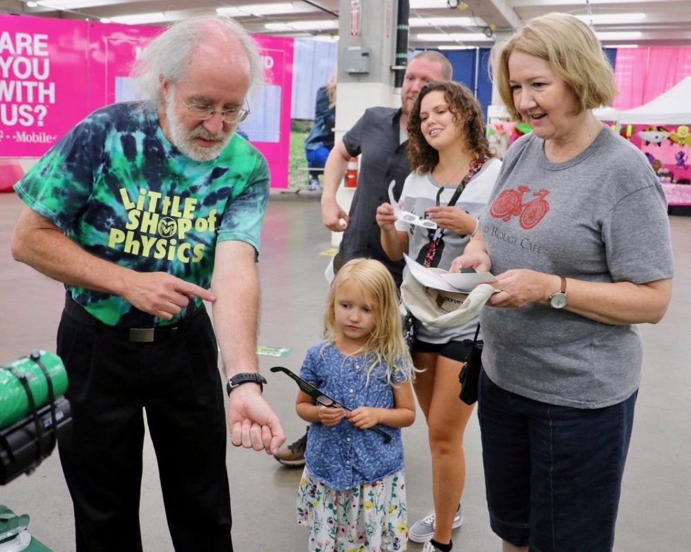 Brian Jones, director of CSU Little Shop of Physics, walks attendees through science experiment at CSU's booth at the 2018 Denver County Fair.