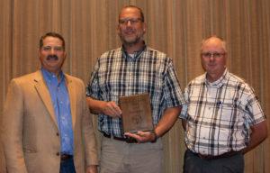 Assistant Professor of Animal Sciences Scott Speidel receives the BIF Continuing Service Award.