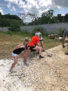 Athletes shoveling gravel in Jamaica