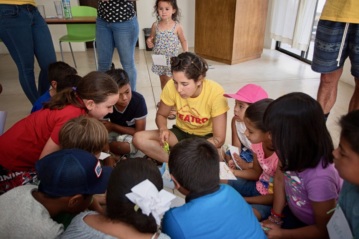 Kids Do It All instructor leads group of kids in activity at CSU Todos Santos Center.