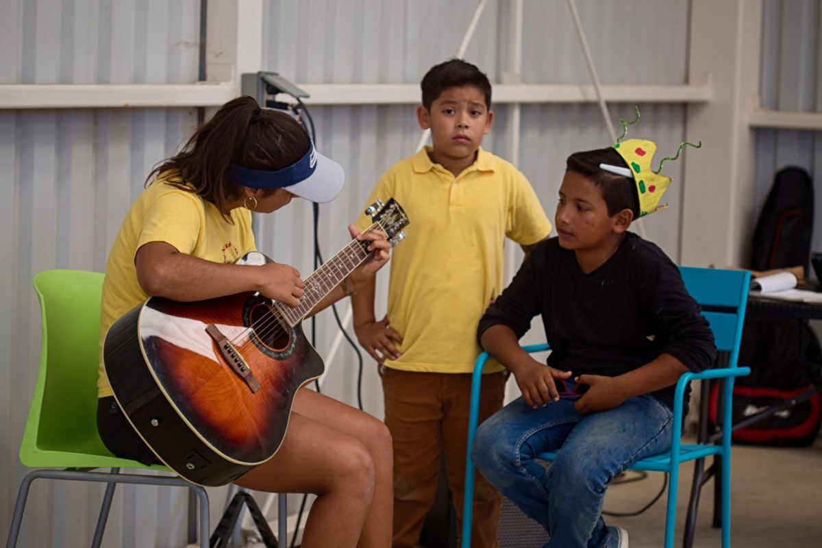 Three youth participating in the Kids Do It All program play music for crowd at the CSU Todos Santos Center.