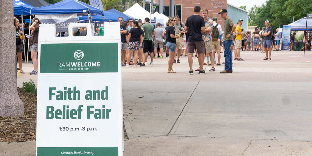 Sign for Faith and Belief Fair on the plaza