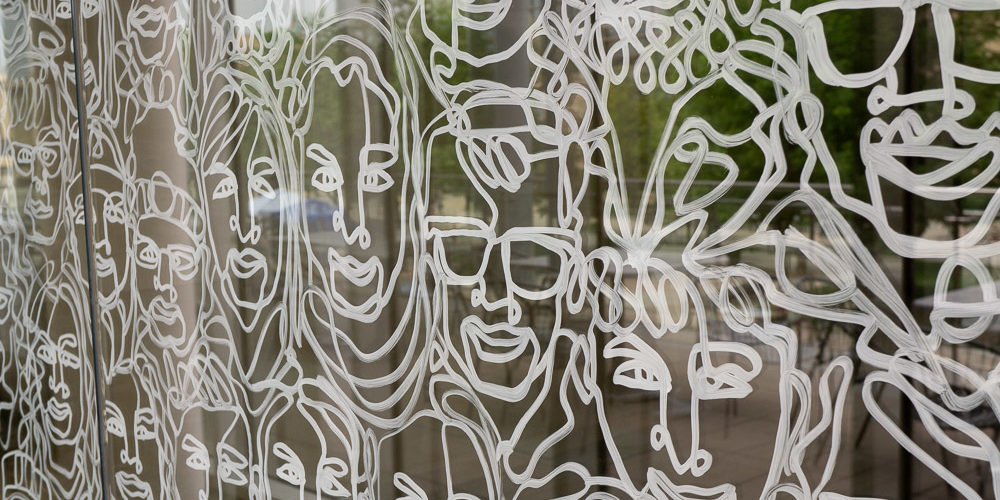 Faces painted on window