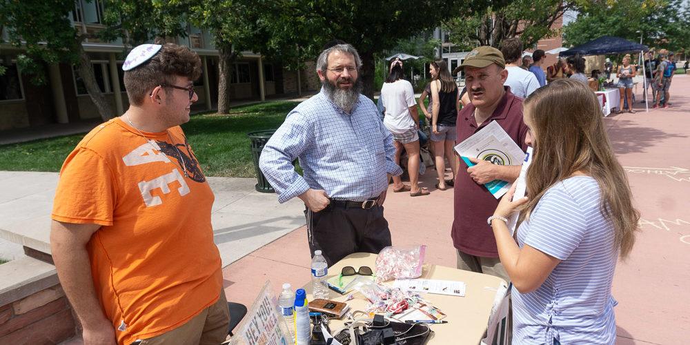 Rabbi and students at Faith and Belief Fair