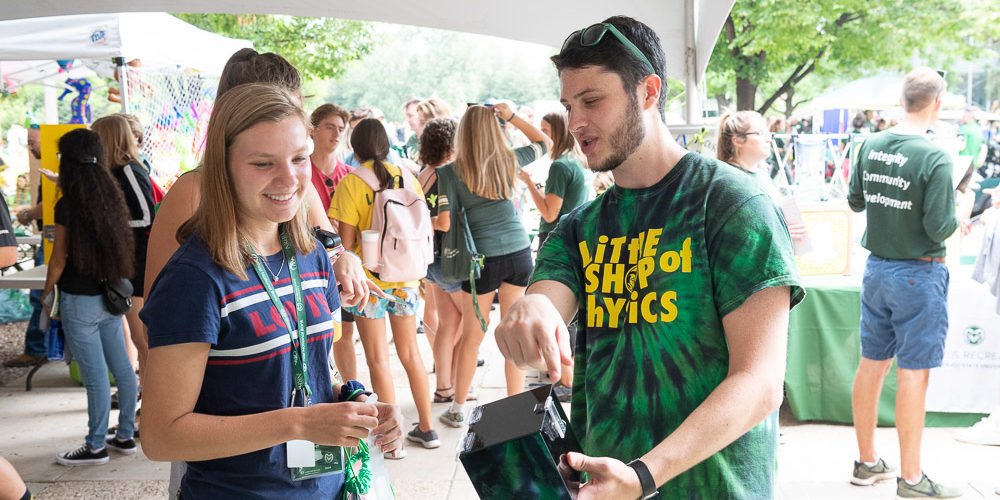Student learns about Little Shop of Physics at Street Fair