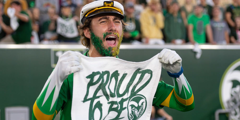 Student with Proud to Be towel