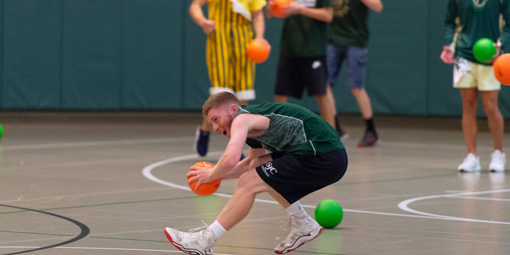 Students playing dodge ball at Rec Center