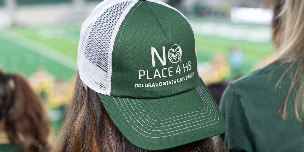 Student wearing No Place 4 H8 hat
