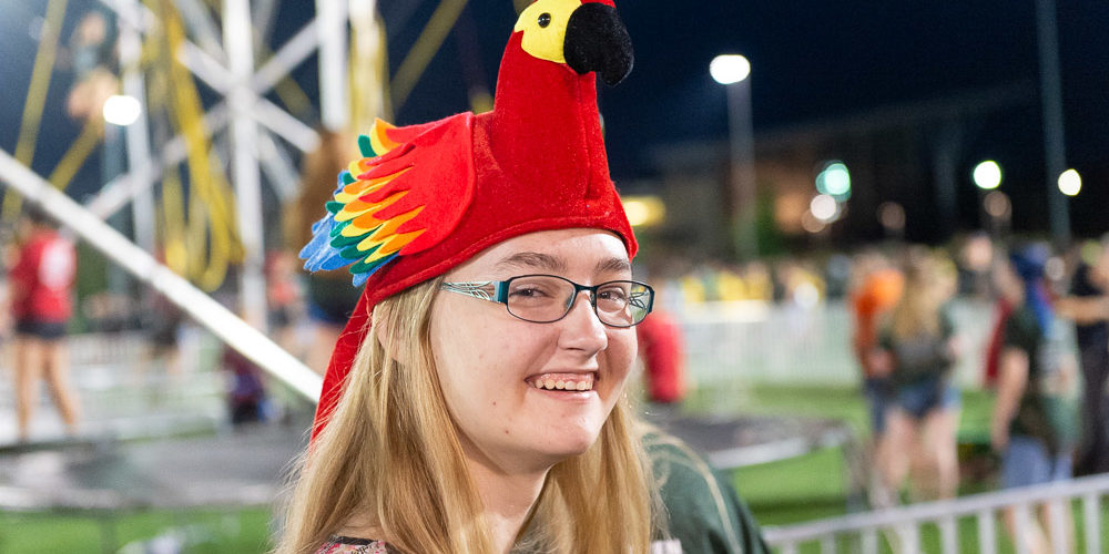 Student in chicken hat at carnival