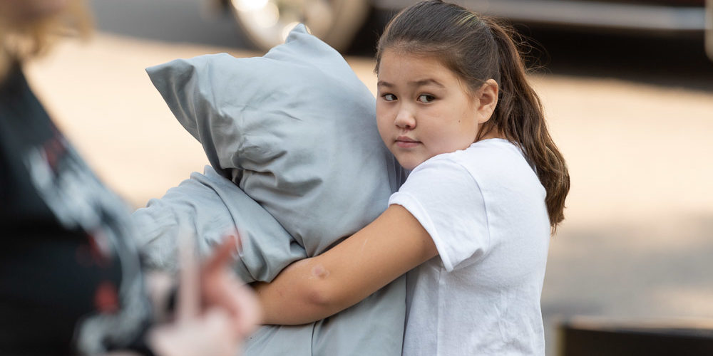 Little sister with pillows