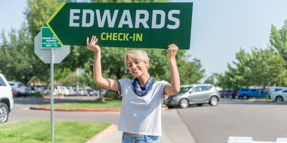 Volunteer at Move In with Edwards Hall sign