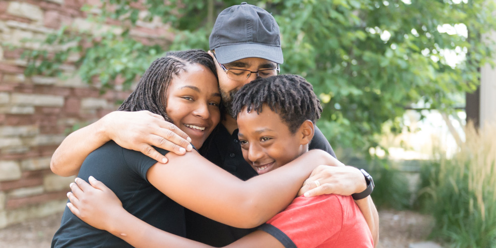 Family hug at move in 2018