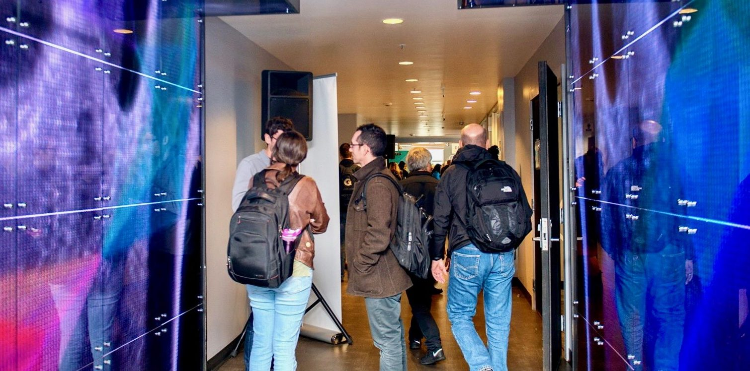 Denver Startup Week attendees walk through light-up hallway at Basecamp, located at The Commons on Champa.