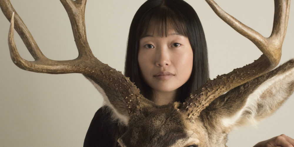 STUDENT WITH DEER ANTLERS