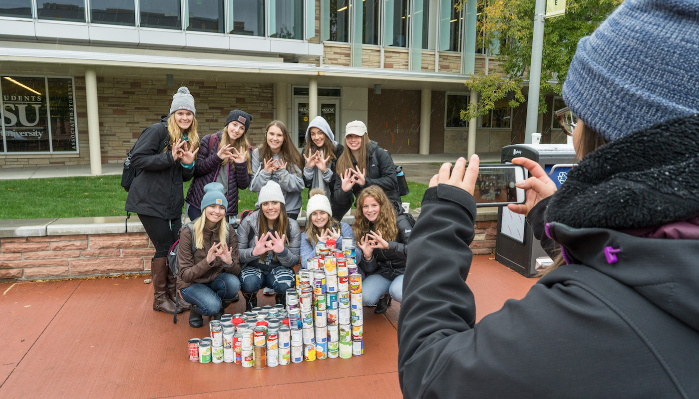 Students with cans