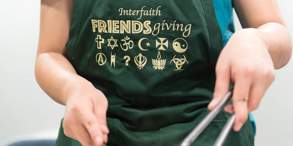 Student in Friendsgiving apron