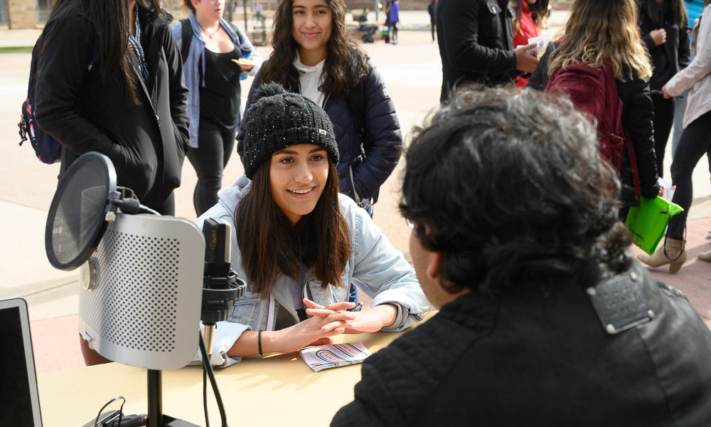 Students interviewing on the plaza
