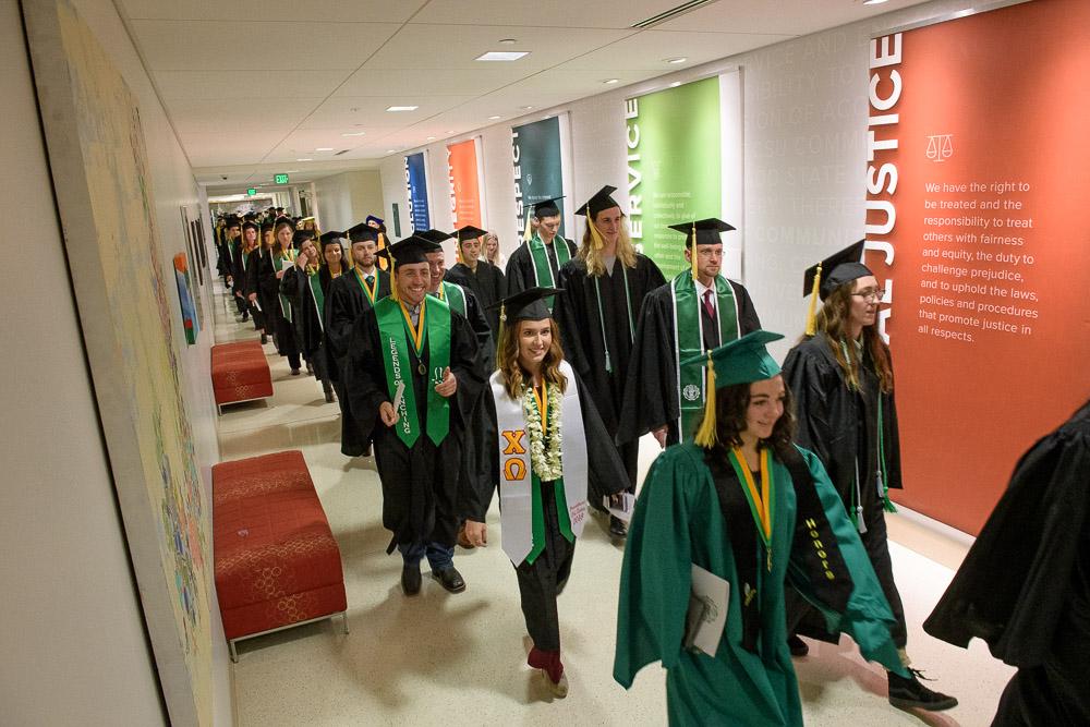 Graduates walking in LSC hallway