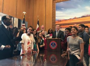 Youth FLTI participants see policy making in practice as former Colorado Gov. Hickenlooper signs bill into law.