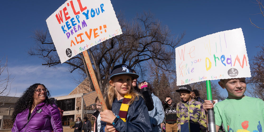 Kids marching with signs