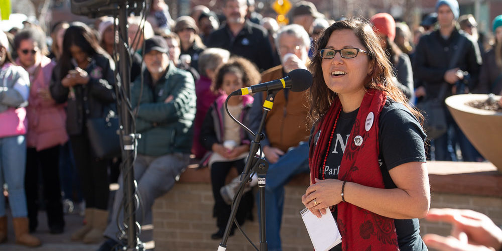 Dominique David-Chavez delivers the charge to marchers