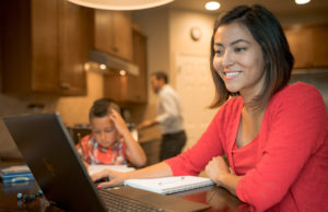 Vashti Batjargal studies at home on laptop for CSU Online