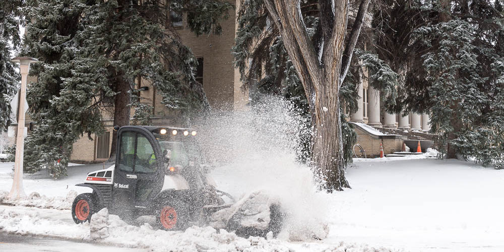 Snow being removed on campus