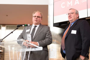 Ray Goodrich and John Wyckoff accept the award for bioscience manufacturer of the year