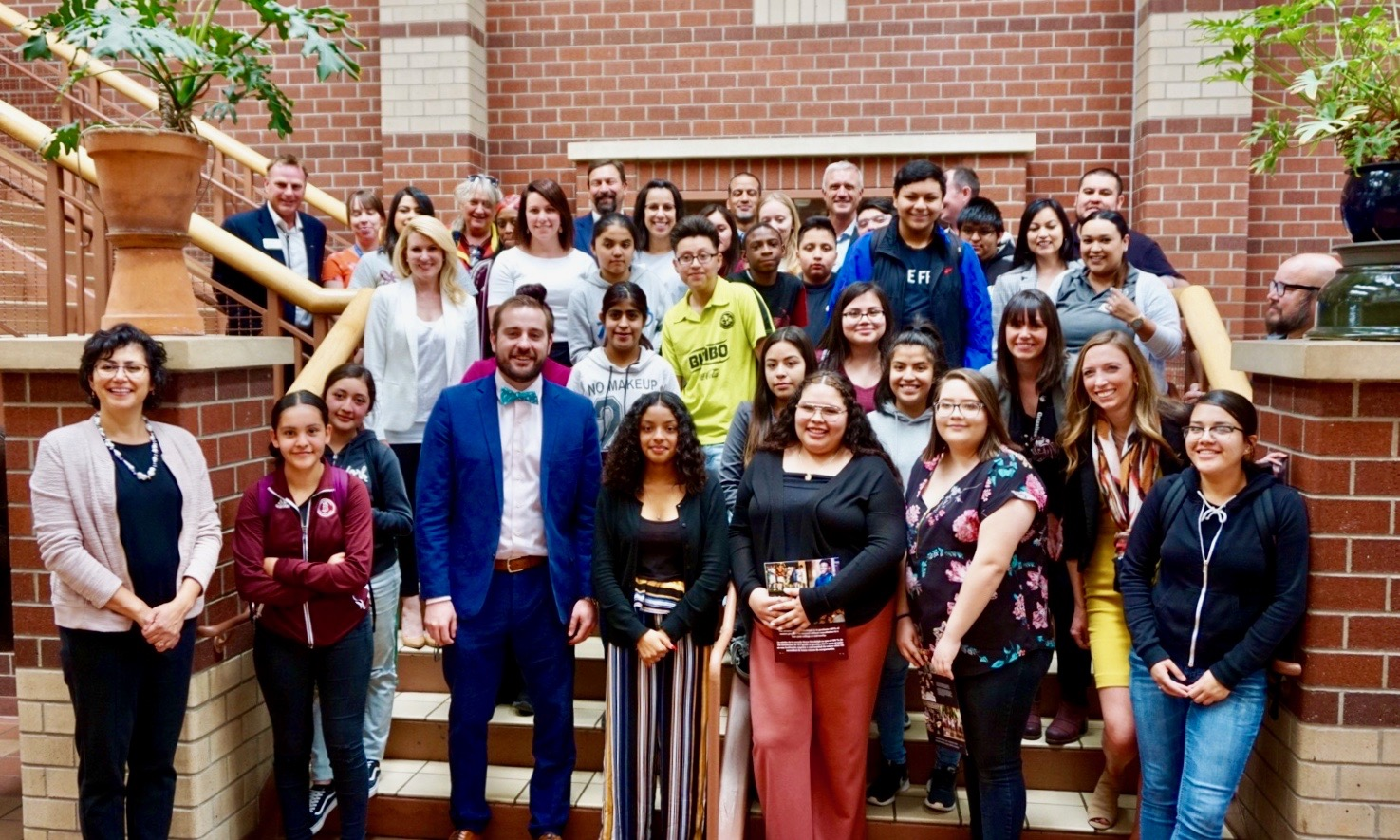 Students and faculty from Bruce Randolph School pose for group photo with faculty and staff from Denver Public Schools, CSU, and the CSU System following MOU signing event in north Denver.