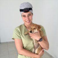 Emma Lantz holding puppy.