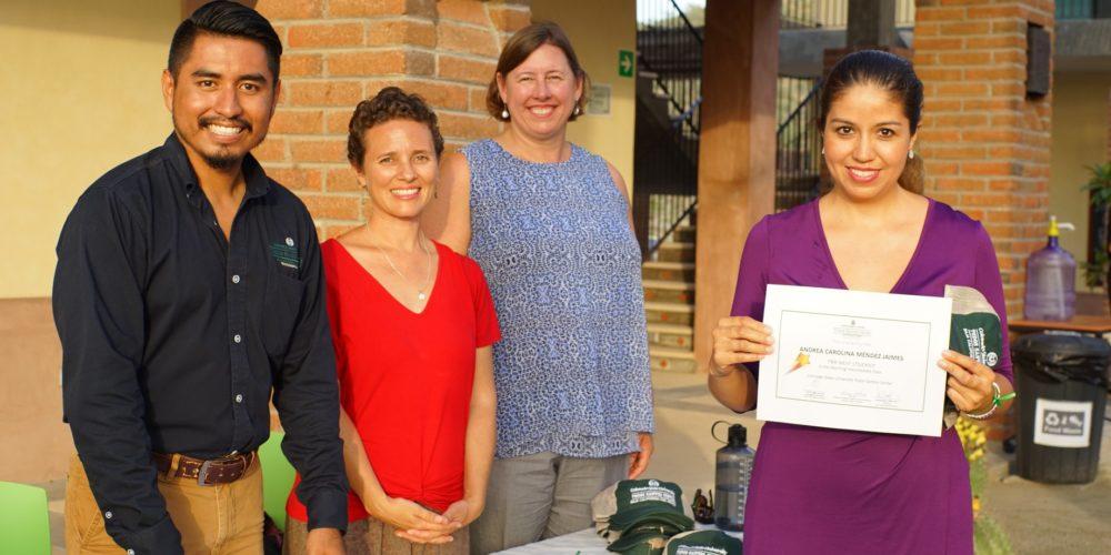 CSU Todos Santos team members Olaf Morales, Aines Castro, and Kim Kita pose with English student during closing ceremony.