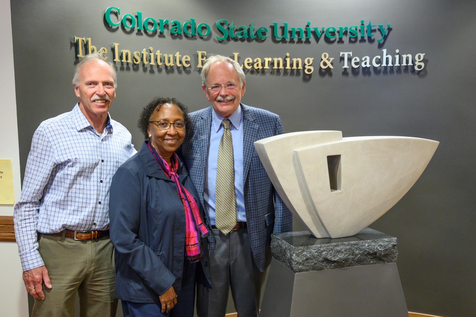 Paul Thayer, Blanche Hughes, Alan Lamborn with sculpture in TILT building