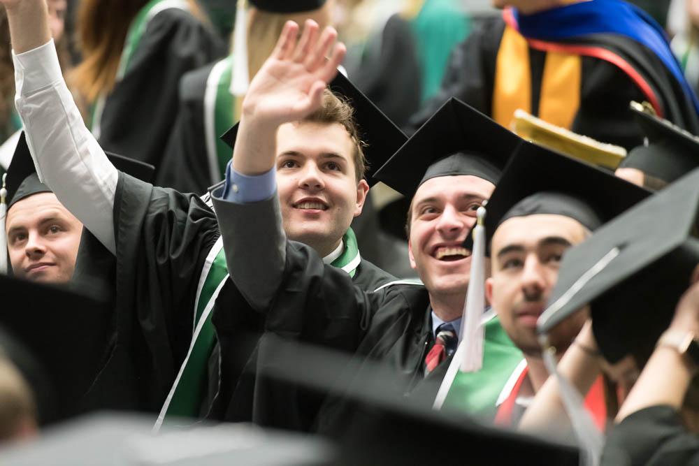 Graduates waving