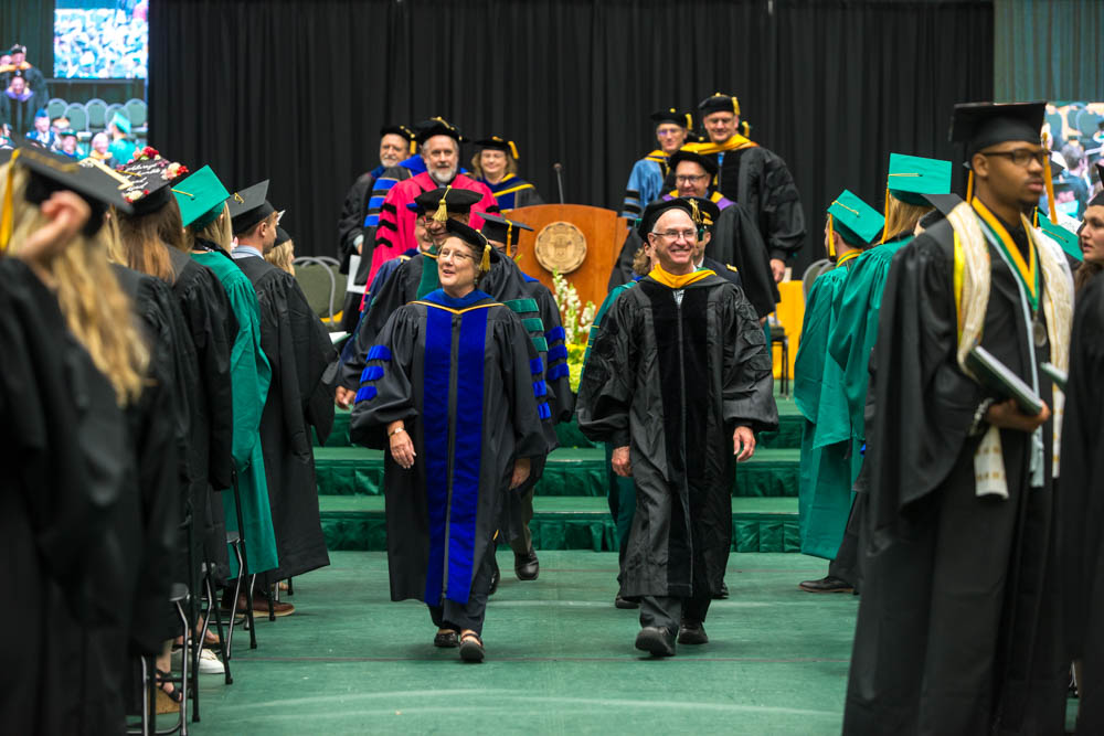 Recessional from stage by dean and faculty