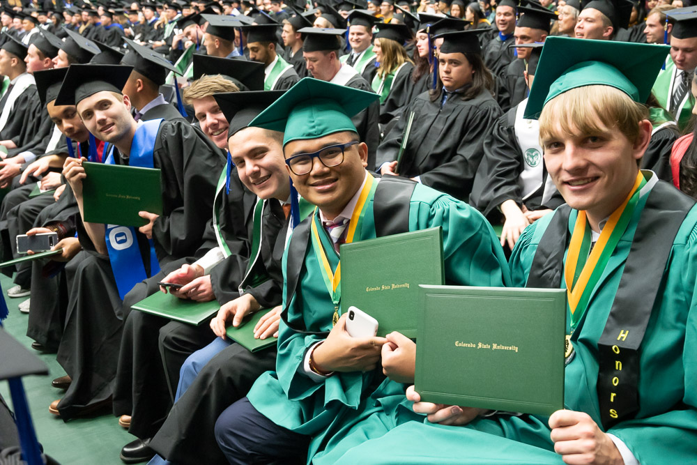 Graduates seated with diplomas