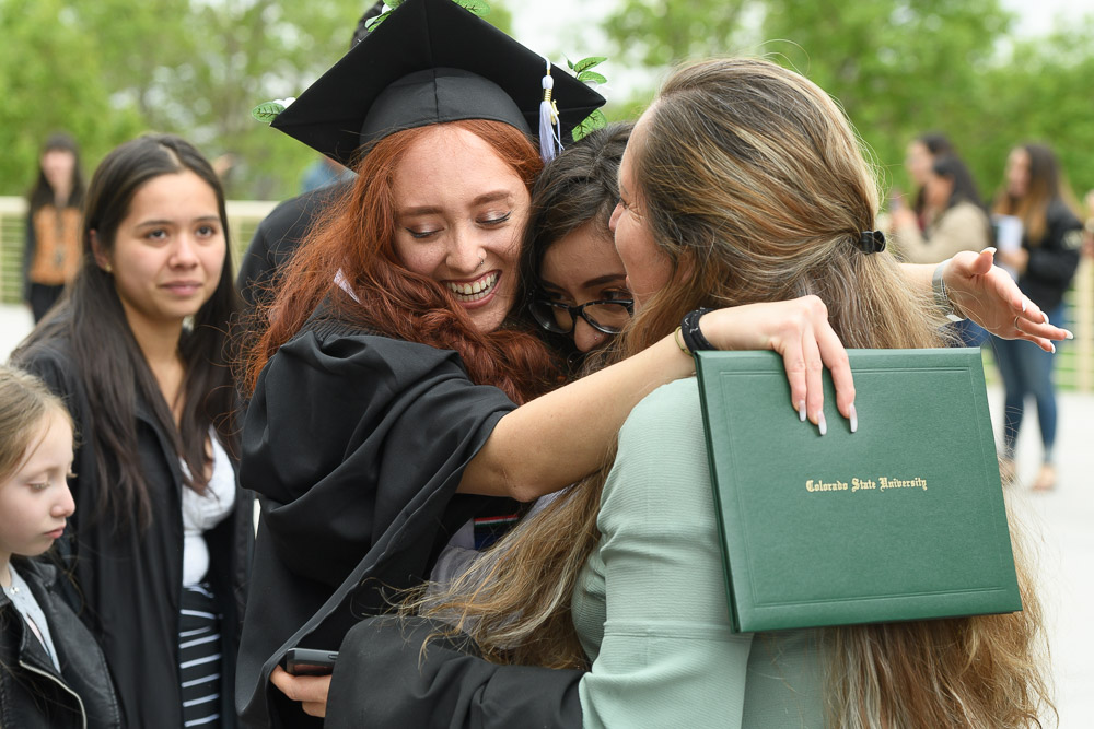 Graduate in family hug