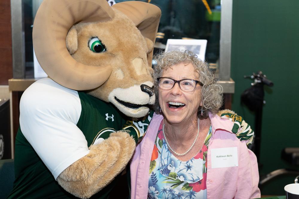 CAM the Ram mascot hugs CSU Online graduate