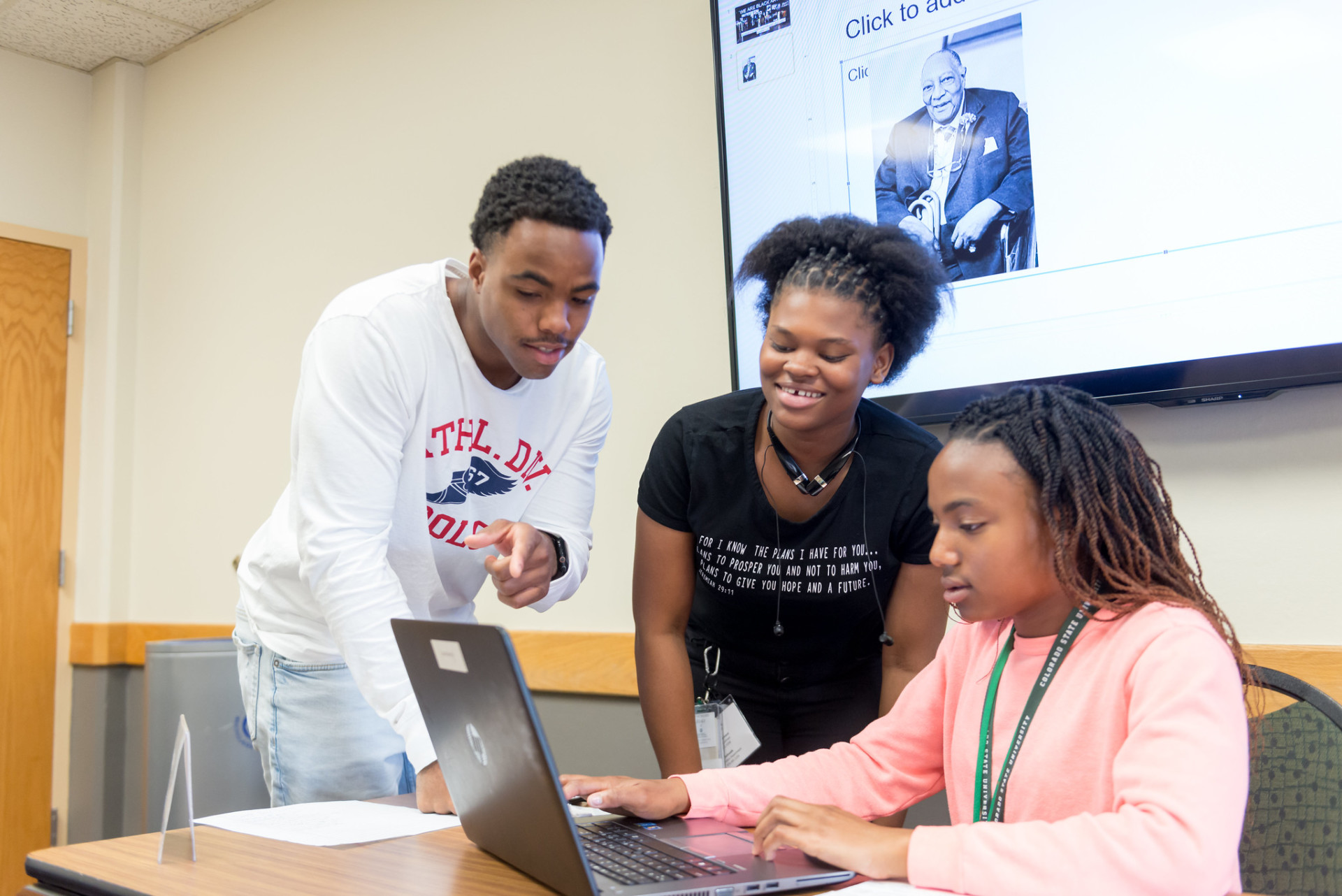 High school students work on computer at Black Issues Forum