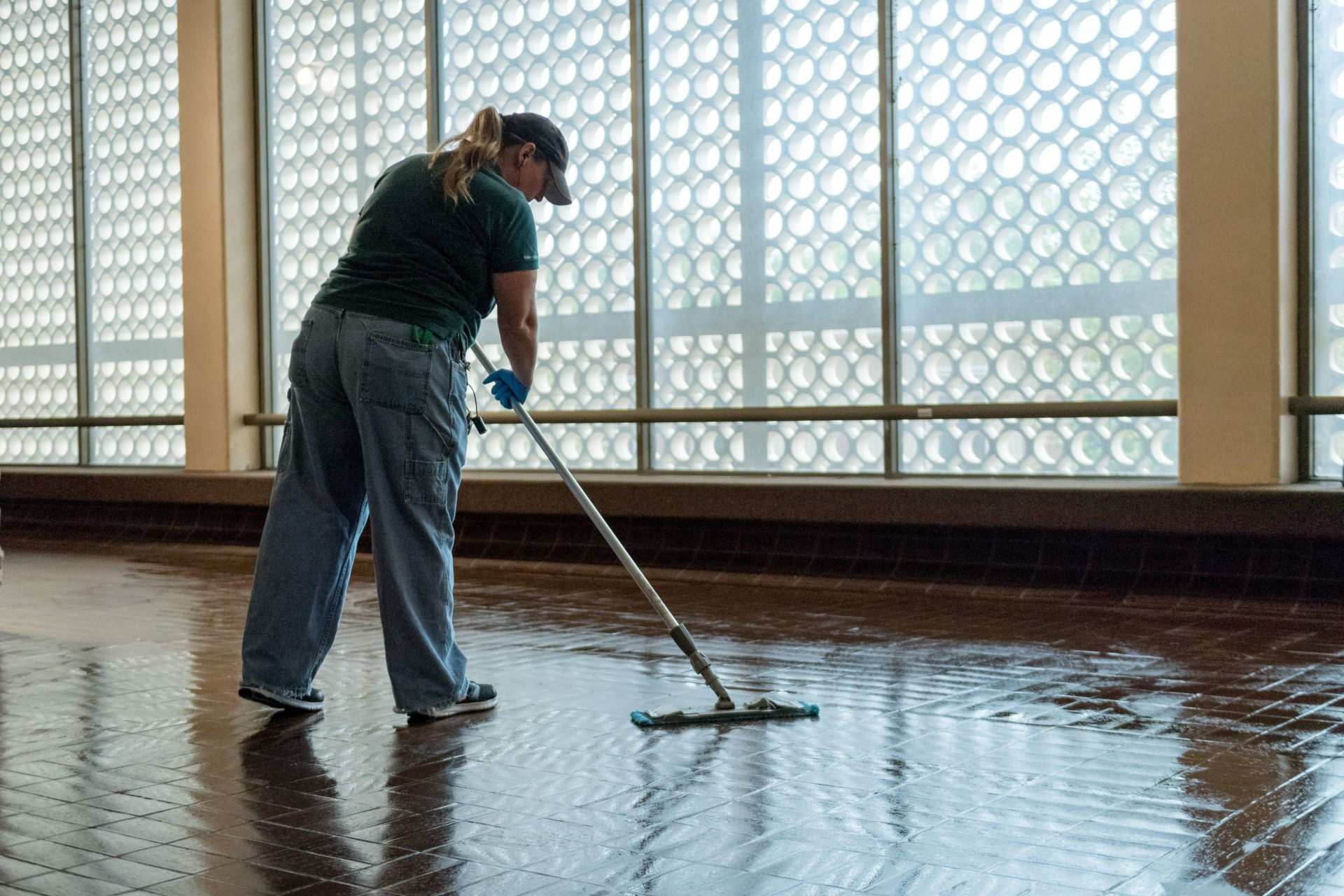 Facilities employee mopping a floor in Clark Building