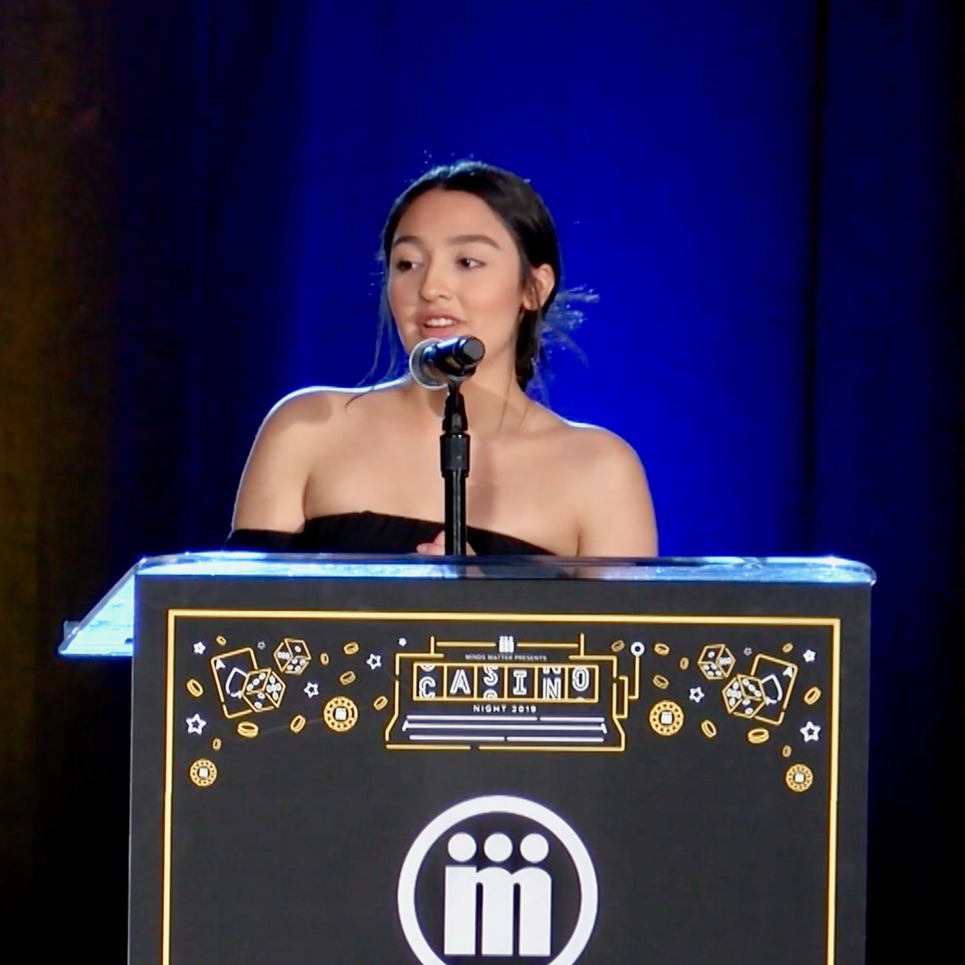Alyssa Ledesma addresses the audience at the annual Minds Matter Casino Night in Denver.