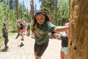 a high school student on the ropes course at CSU's Mountain Campus
