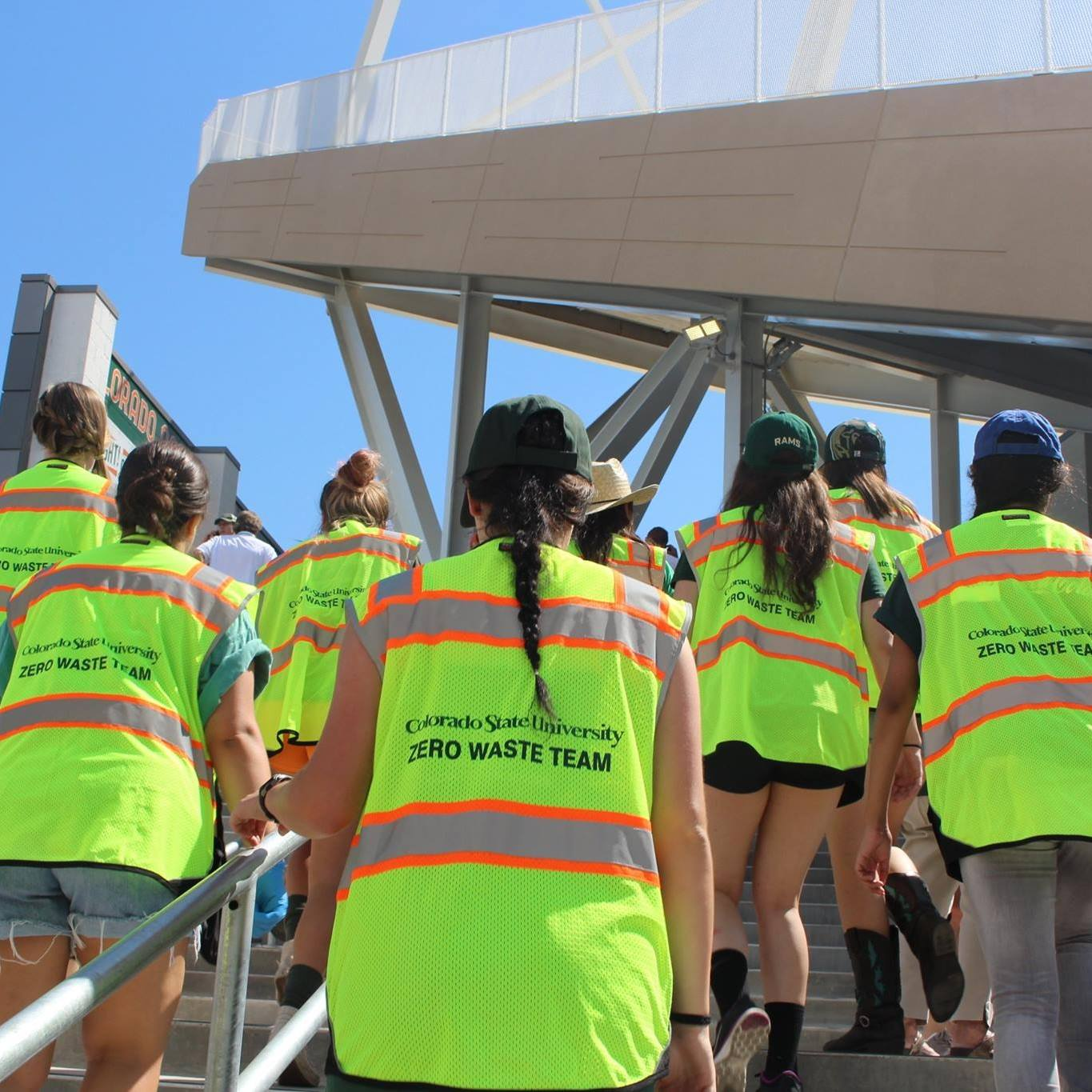 students in the Zero Waste Team walk up stairs at Canvas Stadium