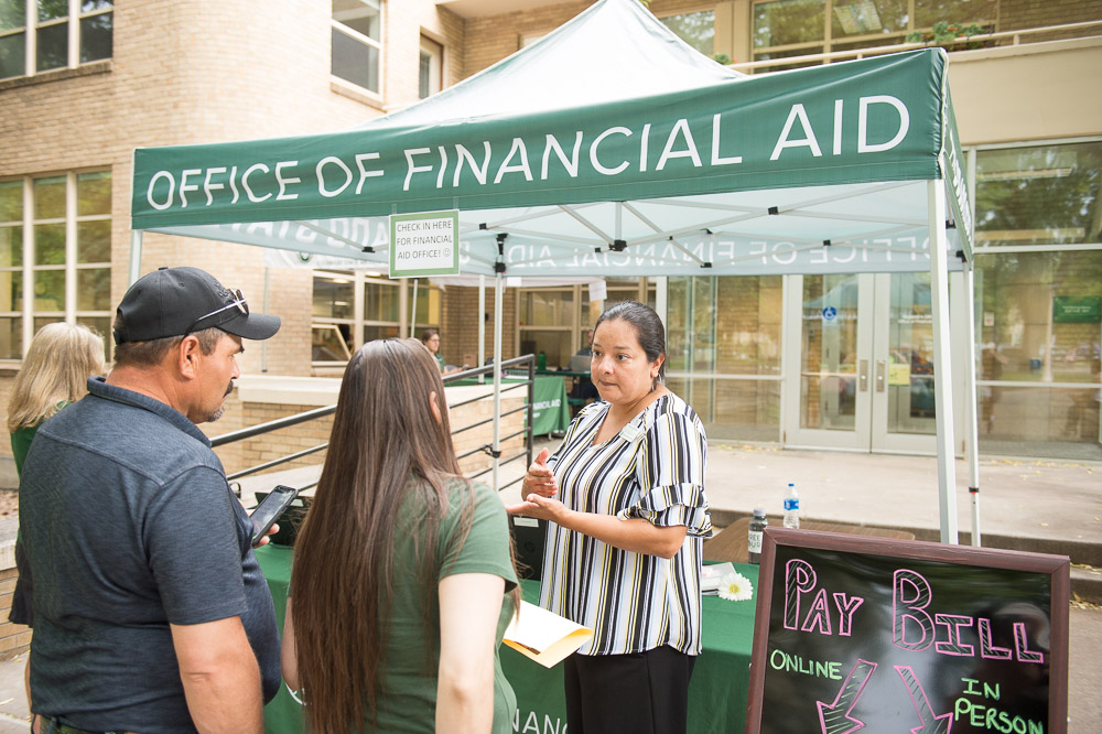 Financial Aid staff talking to parents