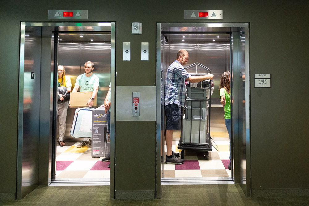 Two elevators full of movers
