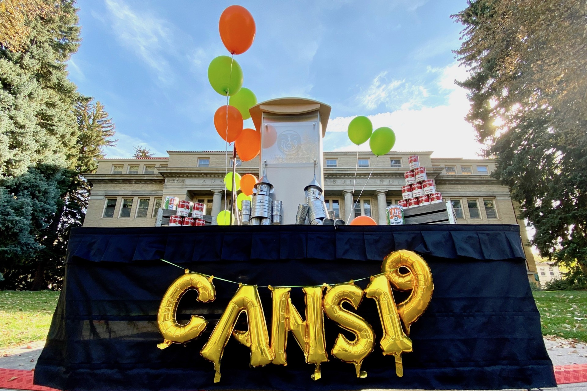 CANS sign with balloons