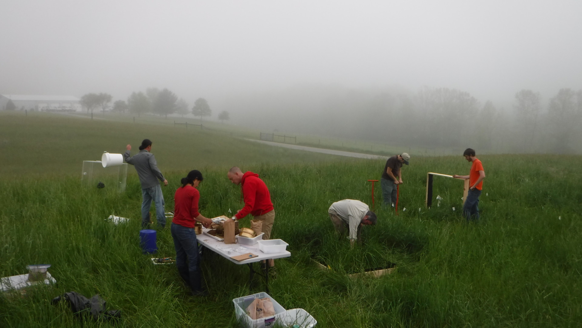 researchers in a field in Virginia, collecting soil samples