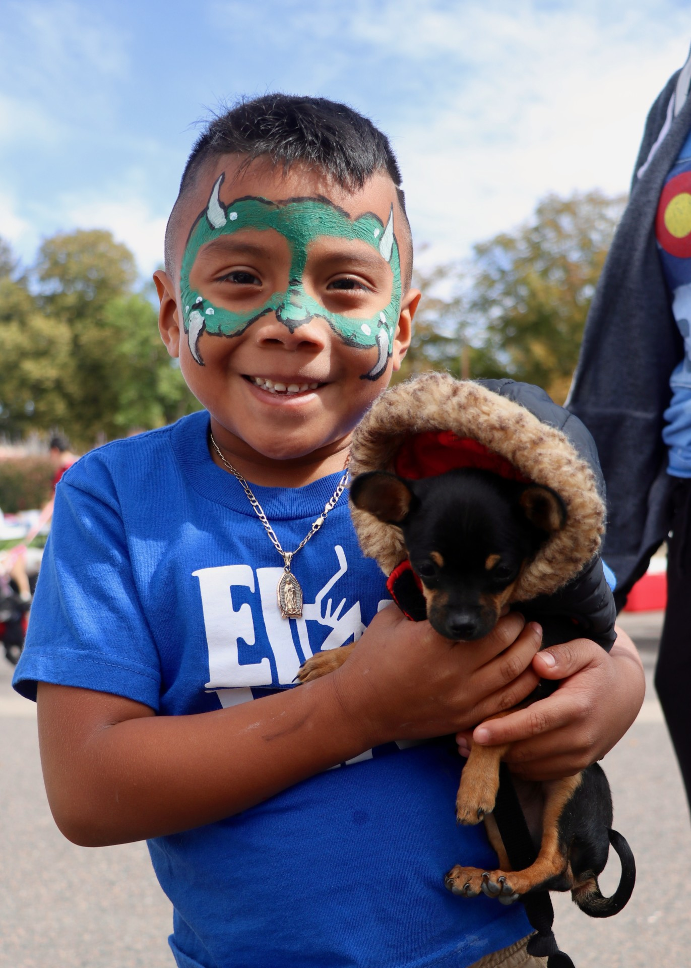 Boy and puppy at Free pet clinic in Denver